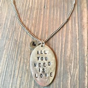 "Hand stamped ""All you need is love"" necklace"
